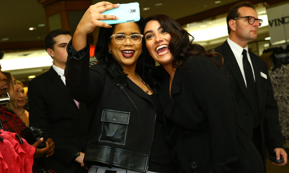 Fashion blogger Nadia Aboulhosn takes a selfie with a fan at the Addition Elle Event with Nadia Aboulhosn at Lord & Taylor on October 7, 2015 in New York City. (Photo by Astrid Stawiarz/Getty Images for Lord & Taylor)