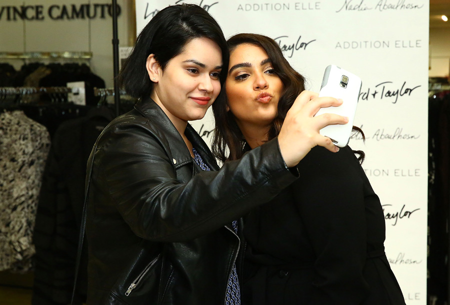 Fashion blogger Nadia Aboulhosn takes selfie with a fan at Addition Elle Event With Nadia Aboulhosn At Lord & Taylor on October 7, 2015 in New York City. (Photo by Astrid Stawiarz/Getty Images for Lord & Taylor)