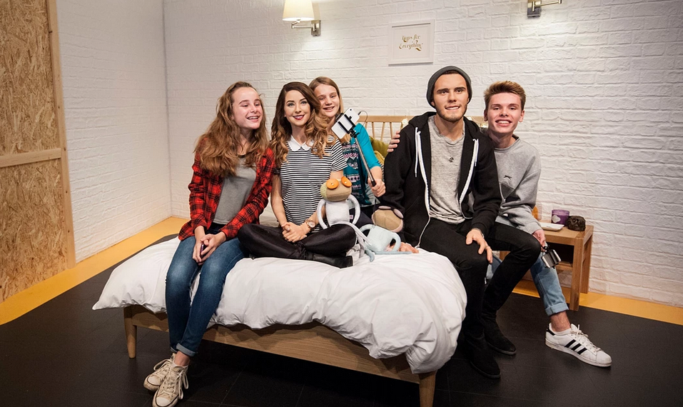 Fans pose for pictures with waxwork figures of vloggers Zoe Sugg and Alfie Deyes Photograph: Lauren Hurley/PA
