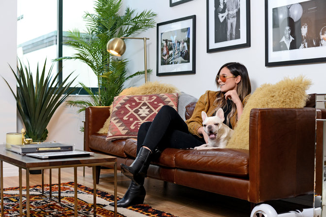 Danielle Bernstein, founder of the fashion blog We Wore What, with her French bulldog, Bleecker. Credit Casey Kelbaugh for The New York Times