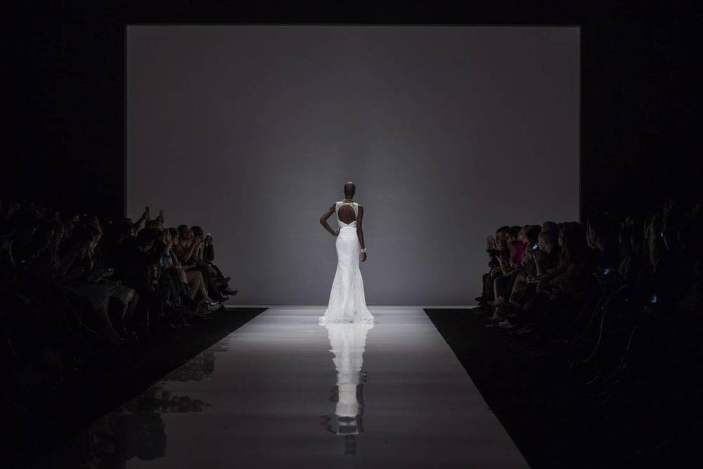 A model walks the runway during the Christopher Paunil show at Toronto Fashion Week in Toronto, Monday, March 14, 2016. Photo Credit: Mark Blinch/AP