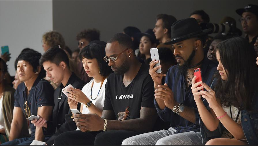 iPhones are a staple of the front row at General Idea's fashion show. (Stephen Lovekin)