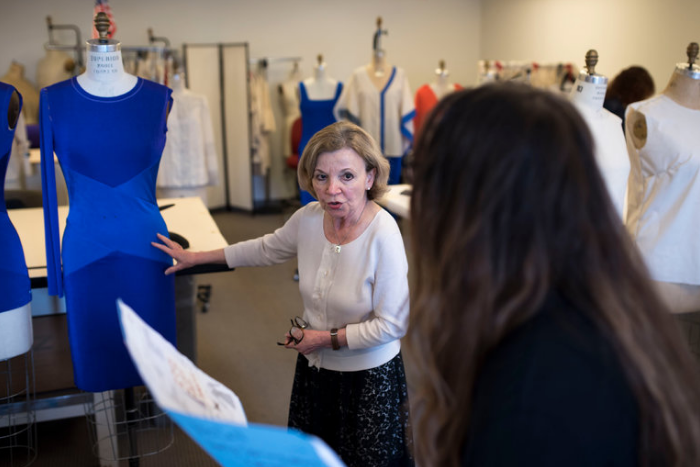 The head of patternmaking, Behnaz Livian, center, and Jacqueline Polikoff, a designer, discuss the cut of a dress. CreditKarsten Moran for The New York Times