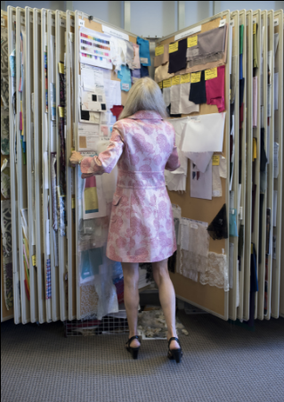 Carolyne Cafaro, the senior vice president and creative director of the McCall Pattern Company in Manhattan, looks through swatches in the fabric library.  CreditKarsten Moran for The New York Times