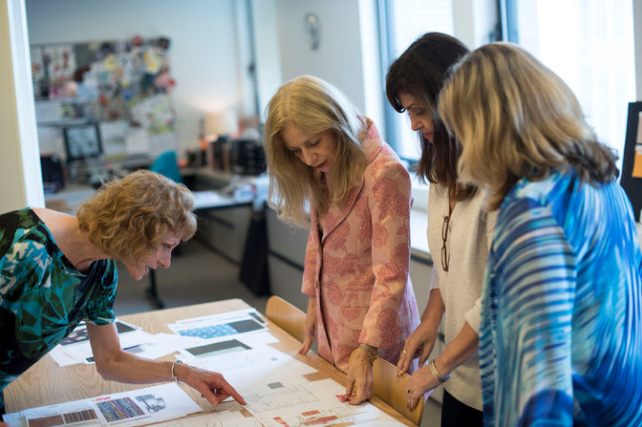 From left: Penny Payne, the fabric and notions editor; Carolyne Cafaro, the creative director; Doree Epstein, a designer; and Leslie Sondy, the director of design and merchandising, go over swatches.'Karsten Moran for The New York Times