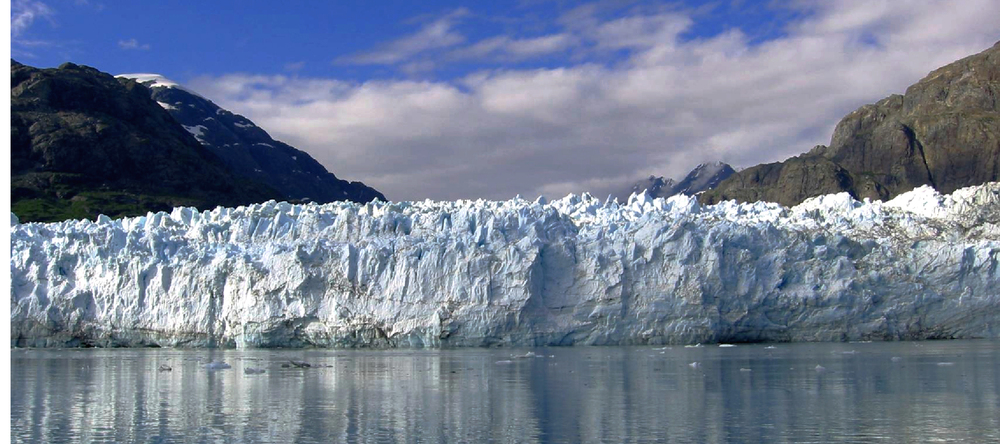 "Margerie Glacier is one of the primary glacier viewing destinations in Glacier Bay National Park. This mile wide face of ice is only a tributary to the greater Grand Pacific Glacier, Known to the Huna Tlingit as  Sit' Tlein.  Oral history is still told of  Sit' Tlein  advancing ""as fast as a dog could run"" forcing the Huna Tlingit out of their homeland and on to what is now known as the community of Hoonah. This is among many narratives shared by Cultural Heritage Guides with visitors to Glacier Bay."