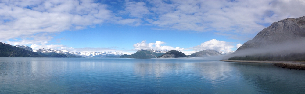A panorama view of Glacier Bay with  Janwu Aani  (Gloomy Knob) to the right. This is a culturally important place where mountain goat fur would be collected by the Huna Tlingit.
