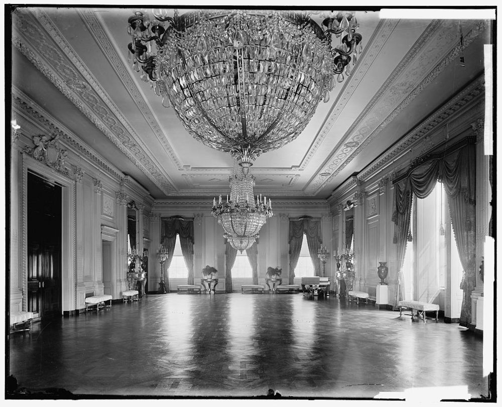 A view of the East Room following its 1902 renovation by Beaux-Arts architect Charles McKim. The gold piano is just visible in the far right corner. (Photo by Harris & Ewing, 1905-1938, Library of Congress.)