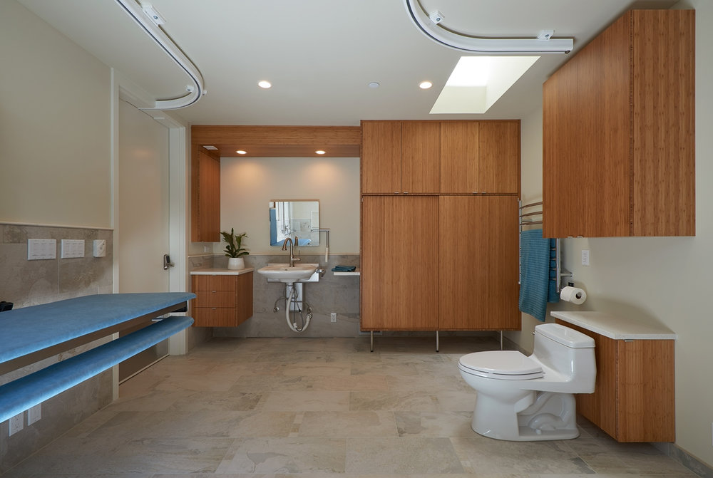 This bathroom was designed to be utilized by the daughter and her caretakers as well as those enjoying the adjacent pool.