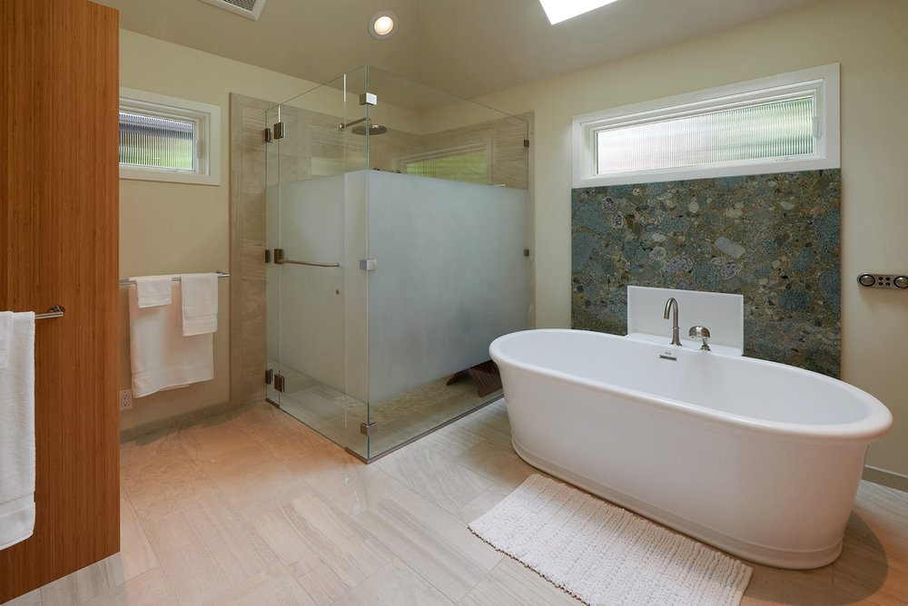 The curbless shower and digital thermostatic controls in the master bathroom are added safety features.