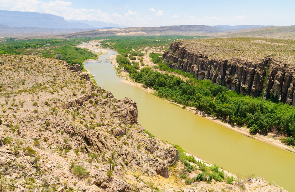 The Rio Grande River flows south, from Colorado into Texas, creating Mexico's northern border then empties into the Gulf of Mexico.  Miguel crossed the river east of Big Bend National Park, which is among the most barren and desolate land in the United States.