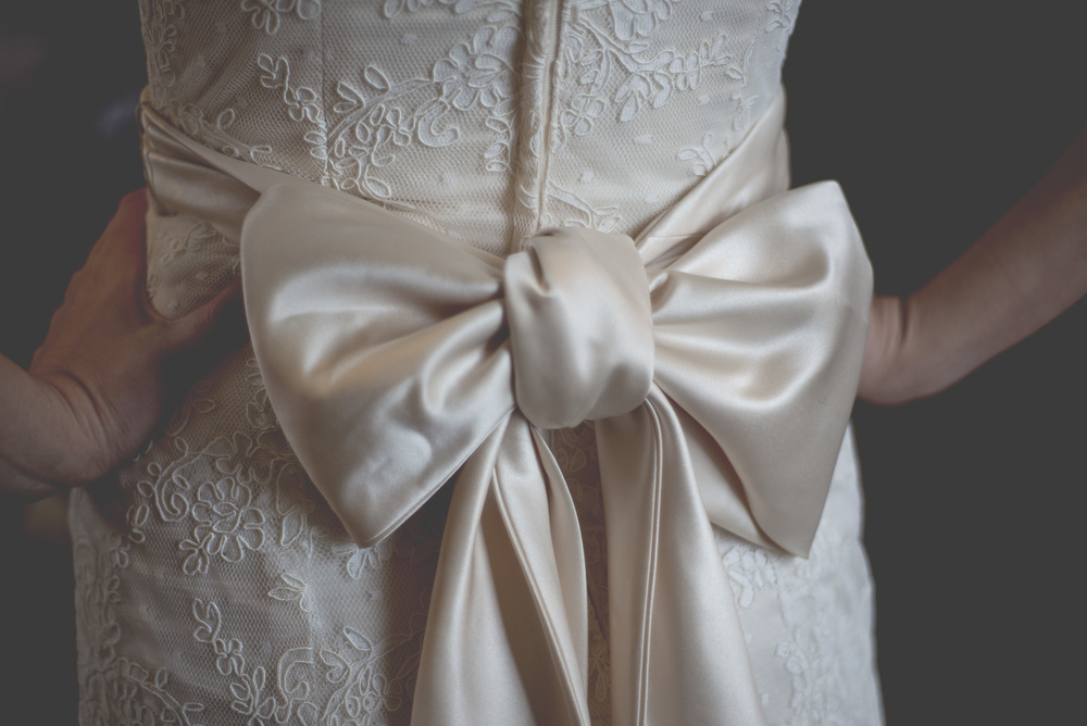 I love the big bow on the back of her dress.