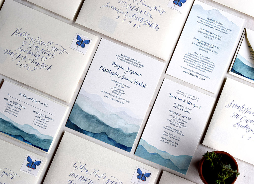 Megan & Christopher: Wedding invitation suite with custom watercolor mountain illustrations.