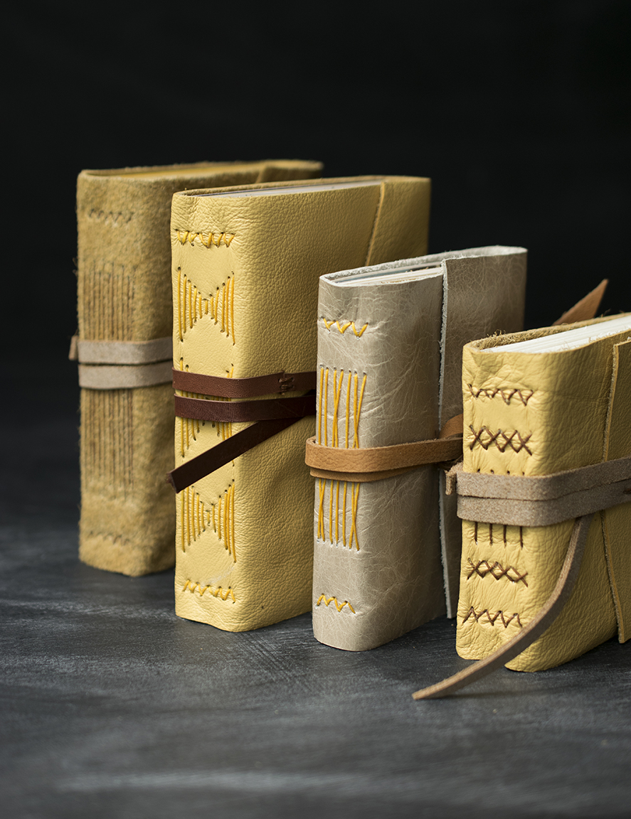quill and arrow leather journal