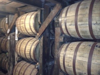 Bourbon aging in white oak barrels, growing ever more delicious