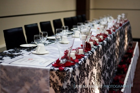 And Of Course Madelines Also Had Their Signature Head Table Dcor That Included Candles Beautiful Red Rose Petals Just POP Against The Damask