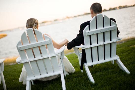 Adirondack chair with newlywed couple