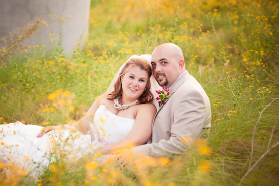 gorgeous lighting with a bride and groom in a field | photo by www.chiphotographyofcharleston.com