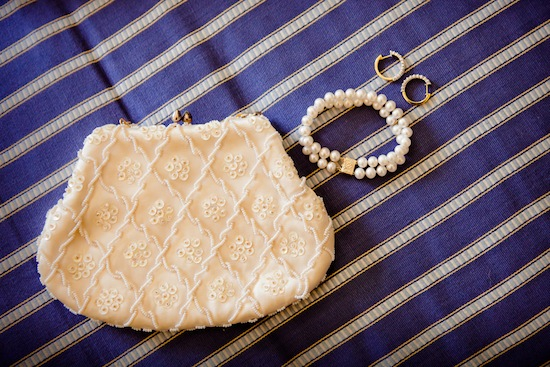 pretty bridal clutch with jewelry | photo by www.chiphotographyofcharleston.com