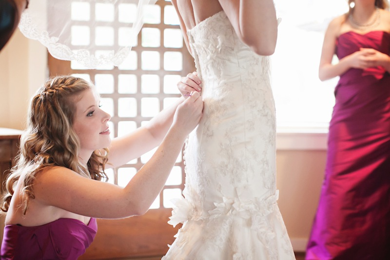 052413-1-slide-bridesmaid-bride-getting-dressed.jpg
