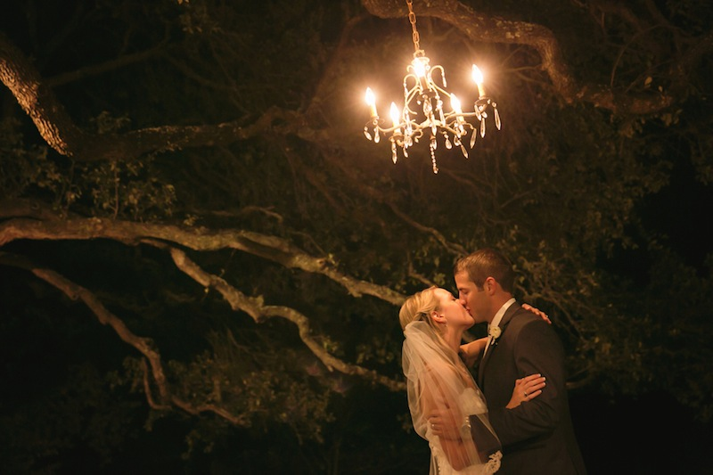 052413-17-no-slide-bride-groom-kiss-under-chandelier.jpg
