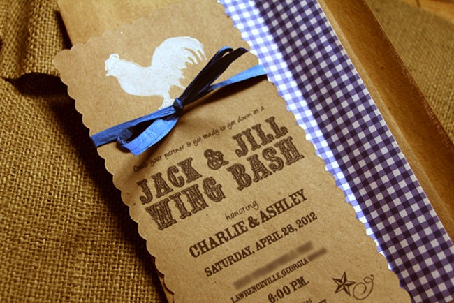 Blue gingham BBQ Wedding Invitation on kraft paper with a rooster silhouette. Features a scallop edge and satin ribbon. From Sweet Magnolia Design - click to see more BBQ Barbecue Wedding Party Invitations on www.BrendasWeddingBlog.com