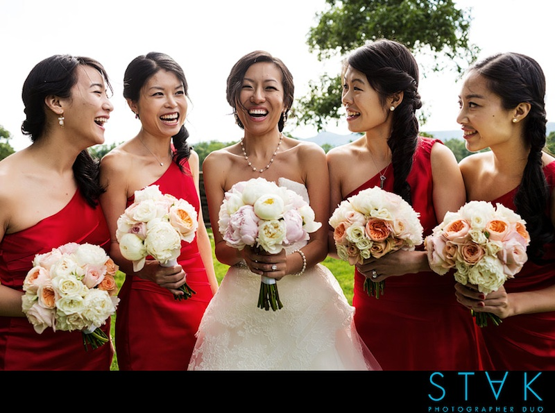 Soft color tones for flowers are a popular summer trend. Selecting a bold color for the bridesmaids dresses will counter the soft understated colors of the flowers.