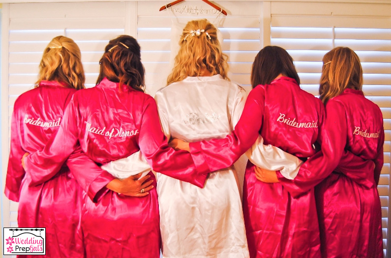 bride and bridesmaids wearing custom embroidered robes from www.weddingprepgals.com