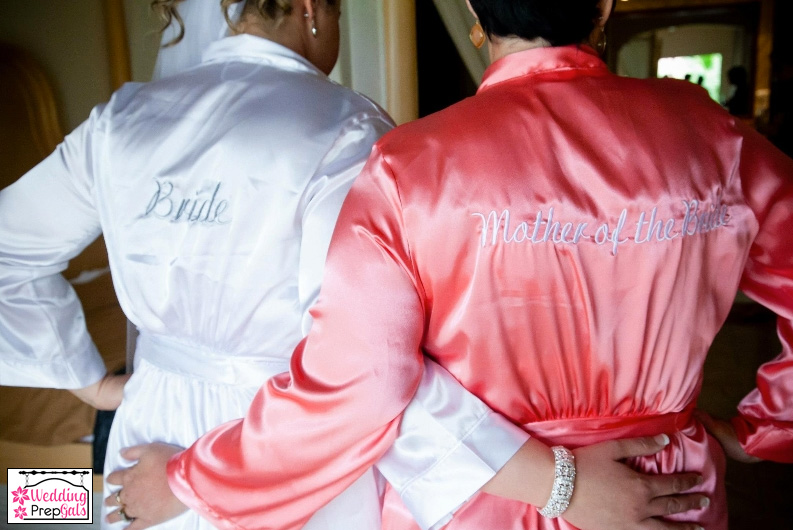 bride and her mother wearing custom embroidered robes from www.weddingprepgals.com