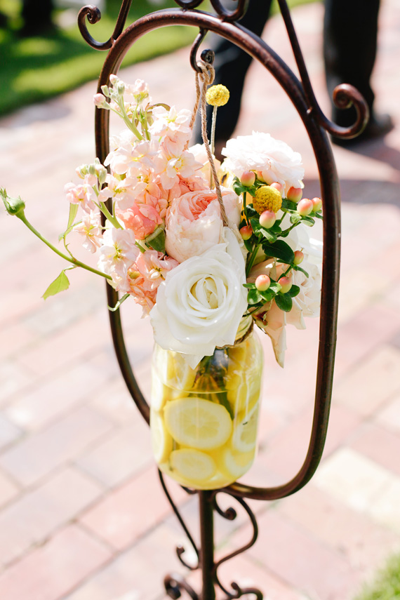 pretty wedding aisle marker flowers with lemons | photo by  www.annabellacharles.com