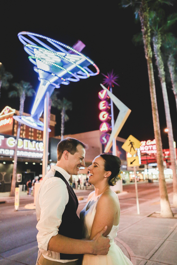 bride and groom at famous Fremont Street in Las Vegas | photo by The Amberlight Collective