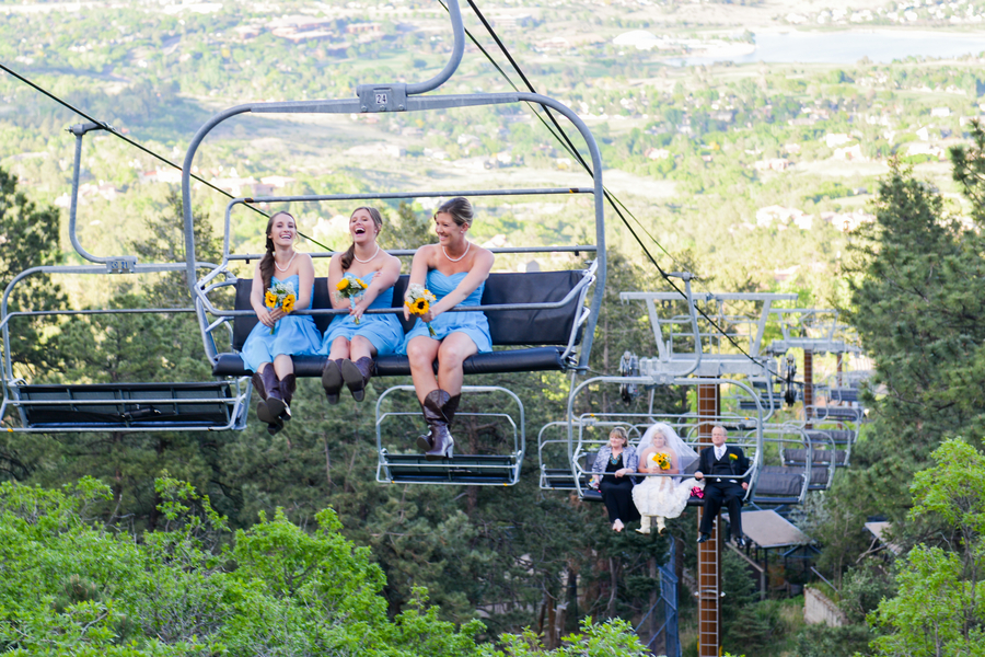 Chairlift ride to the wedding | Cheyenne Mountain Zoo wedding | photo by Trystan Photography