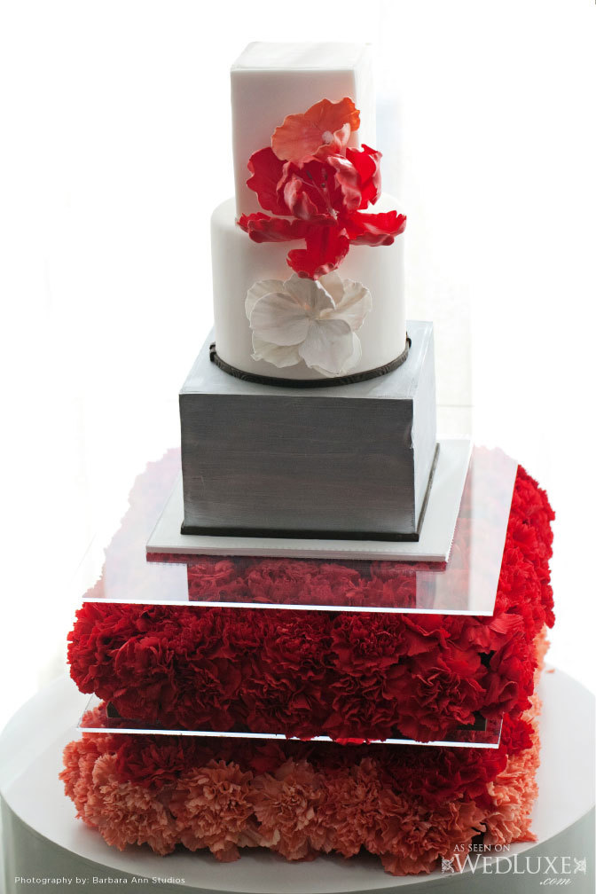 Modern Wedding Cake in red, white and grey with carnations in tiers as the base