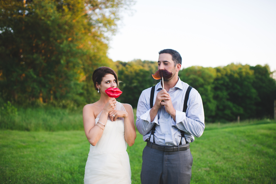 The cutest photo props - big red lips and a mustache for the bride and groom | photo by Jessica Oh Photography