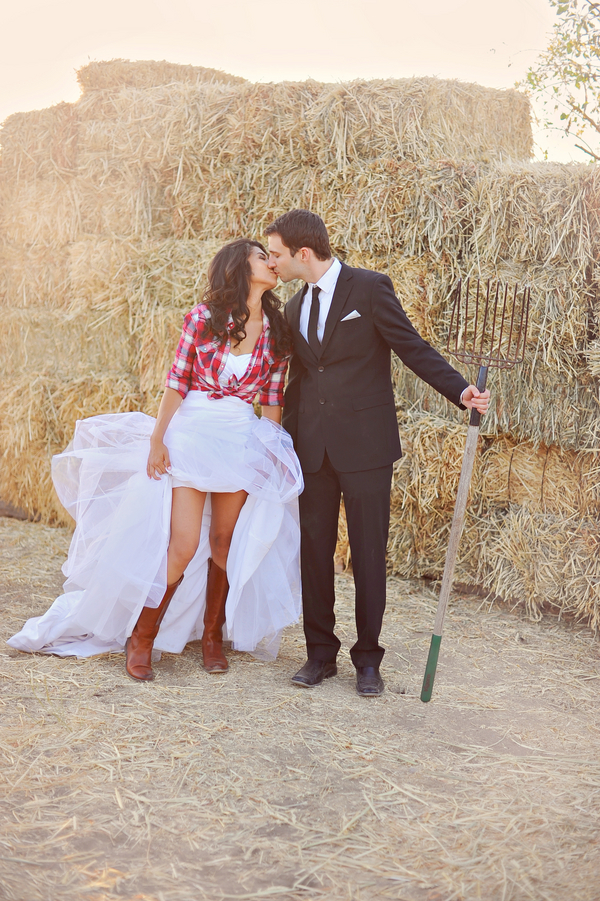 Cute photo of a couple on the farm with the bride wearing a plaid shirt | from Arina B Photography