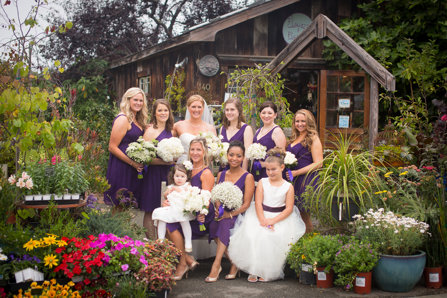 Bride and her Wedding Party, group photos taken in a Flower Shop and Nursery | photo by Portrait Design by Shanti