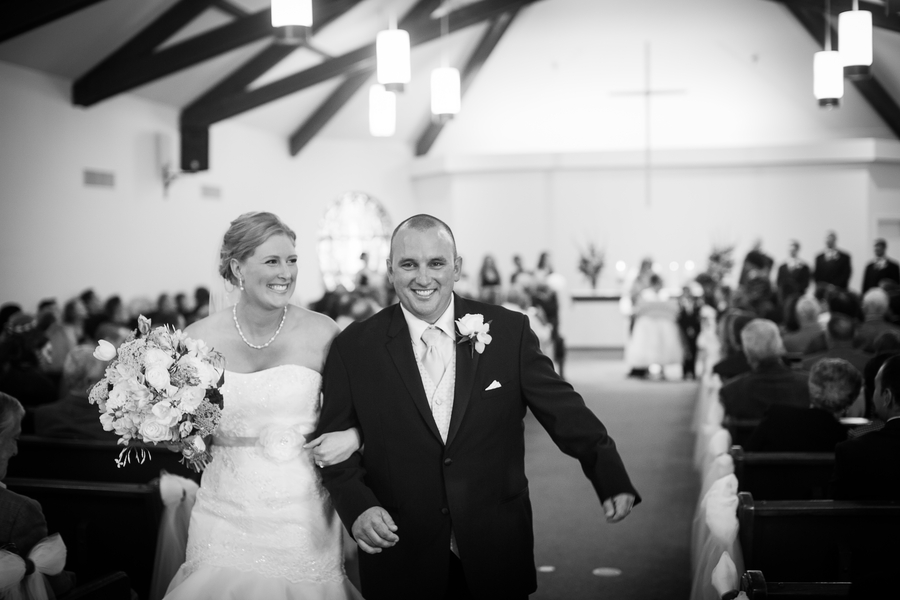 happy couple walking down the aisle | photo by Portrait Design by Shanti