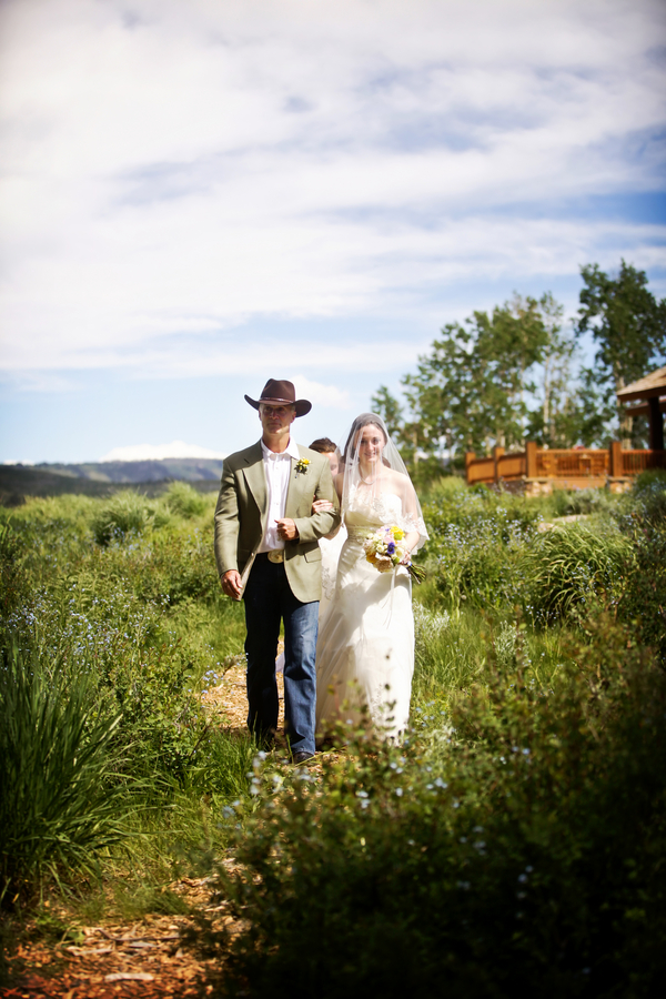 bride and her dad walking down a wildflower aisle in a Utah wedding | photo by Pepper Nix Photography