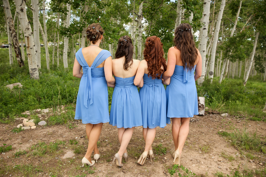 love the backs of the bridesmaids cornflower blue dresses - each one is different | Pepper Nix Photography