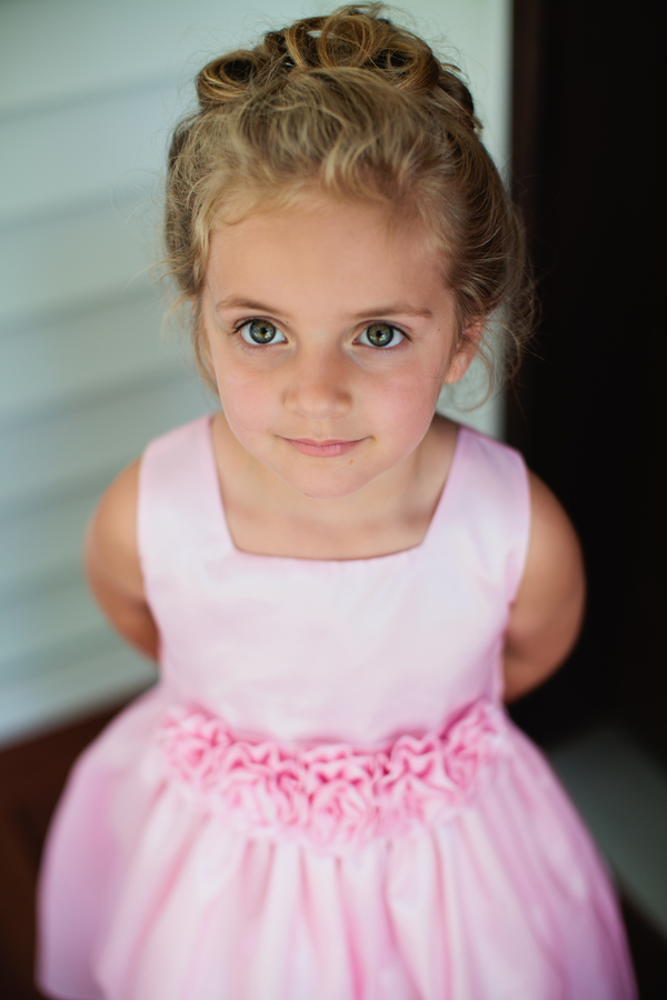 beautiful flower girl in a pretty pink dress | photo by Mary Dougherty Photography