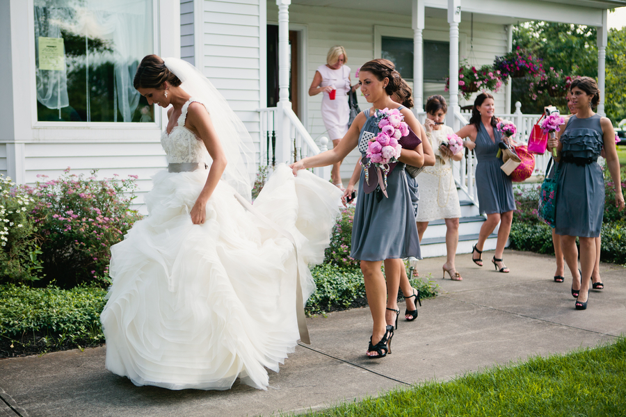 the bride and her bridesmaids walking to the church | photo by Mary Dougherty Photography