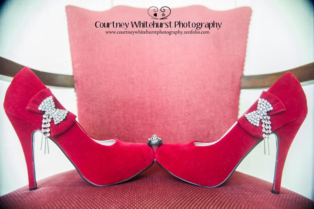 Fun wedding ring shot - balanced on red velvet heels with bling bows | photo by Courtney Whitehurst Photography www.courtneywhitehurstphotography.zenfolio.com