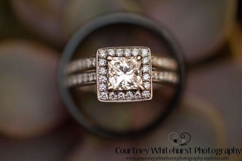 Great ring shot of the bride's wedding ring and engagement ring inside the groom's wedding band | photo by Courtney Whitehurst Photography www.courtneywhitehurstphotography.zenfolio.com