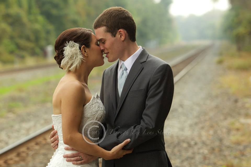 Sweet moment captured with the bride and groom in focus as their background fades away | by Bill Fraser Through The Lens Studio www.ttlsphoto.com