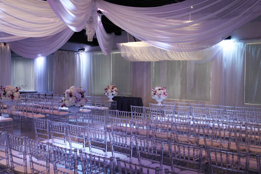 gorgeous wedding ceremony area with draped fabric from ceiling | photo by Tab McCausland Photography