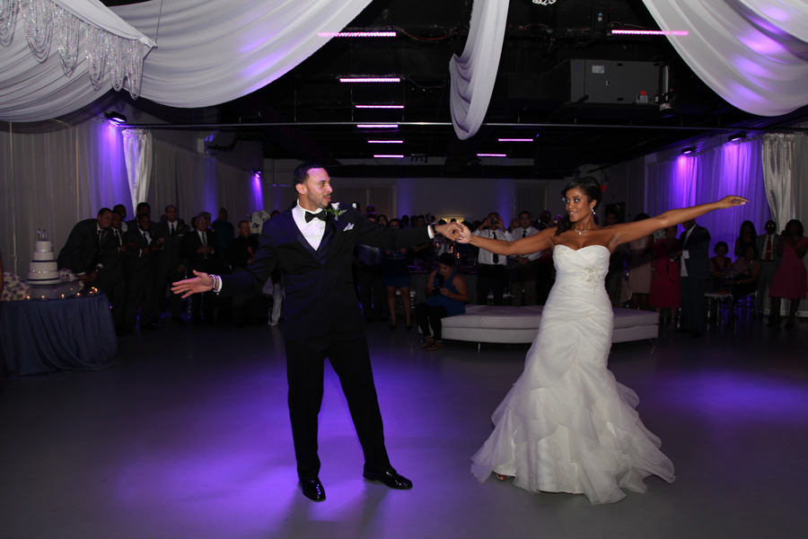 first dance with purple uplighting at reception | photo by Tab McCausland Photography