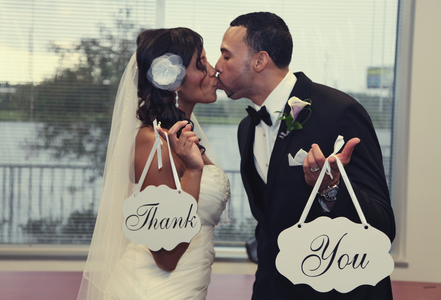 sweet thank you signs held by the bride and groom | photo by Tab McCausland Photography