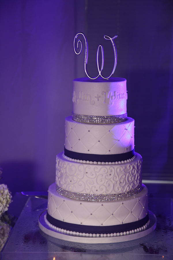 4-tier wedding cake with monogram cake toppers | photo by Tab McCausland Photography