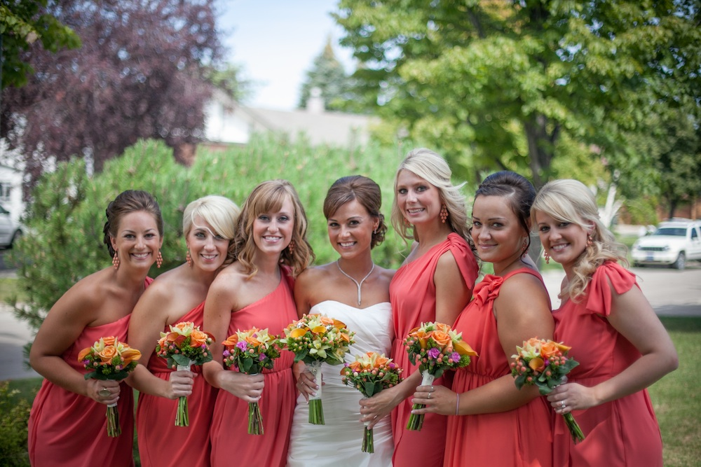 Bridesmaids in pretty coral dresses from Madeline's Weddings & Events in Canada | via the Wedding Vendors I ♥™ Guide on www.brendasweddingblog.com