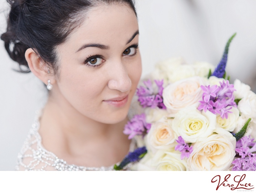 gorgeous bride with her purple, peach and white bouquet | photo by VeroLuce Photography